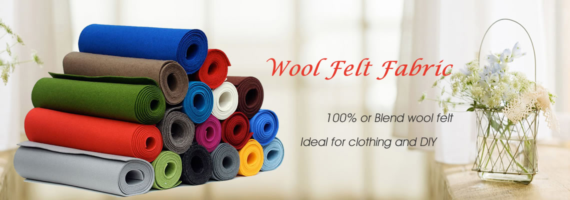 Several rolls of wool felt fabric with different color on the light color background.