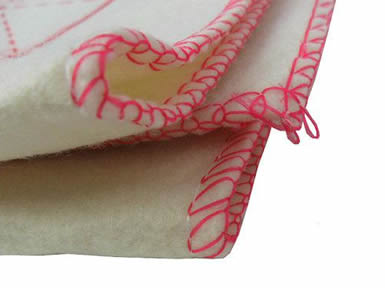 A folded natural white calligraphy writing wool felt with red overlock.