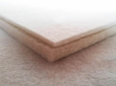 Two pieces of natural white calligraphy wool felt with different thickness.