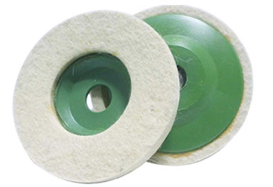 Two wool felt polishing wheels with green plastic back.