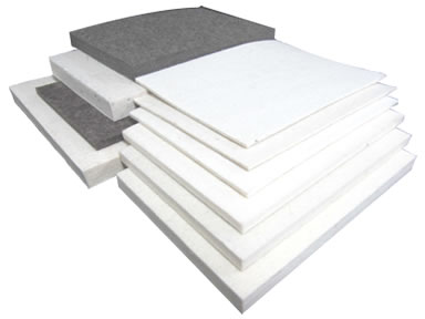 Ten pressed wool felt sheets on the white background with different thickness.