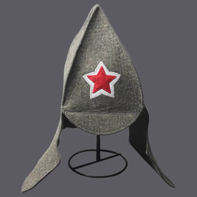 A gray ear-flap sauna hat with a red star applique on it.