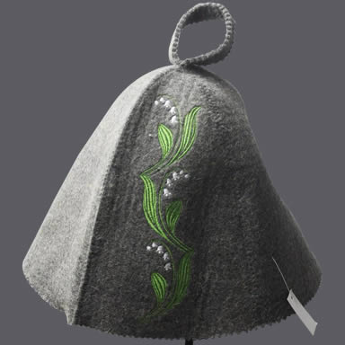 A gray sauna hat with green leaves and white small flower embroidery picture on it.