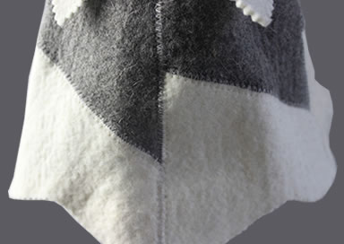 A detail of sauna hat overlock of natural white and gray