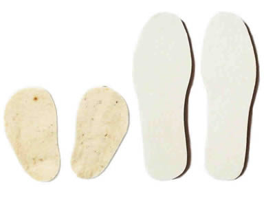 Two pairs of wool felt insoles on the white background.
