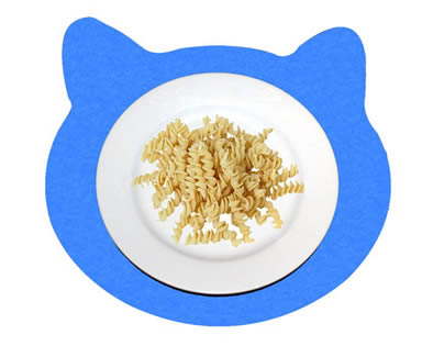 A plate of pasta on the blue cat shaped wool felt placemat.