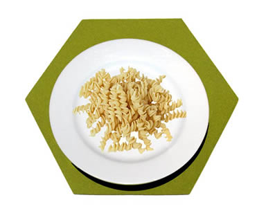 A plate of pasta on the olive green hexagonal wool felt placemat.