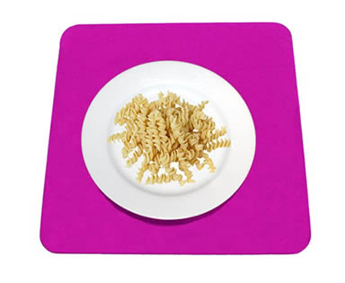 A plate of pasta on the dark pink square wool felt placemat.