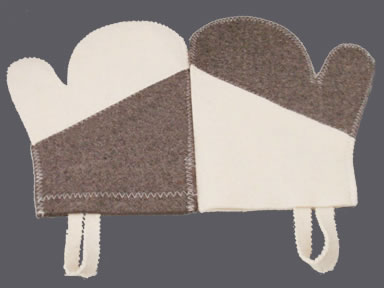 A pair of natural white and dark brown wool felt gloves with patchwork structure.